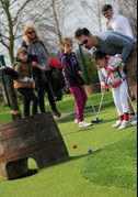 Man and child playing Adventure Golf