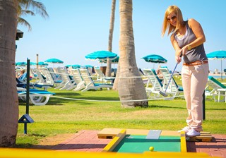 Woman playing Mini Golf